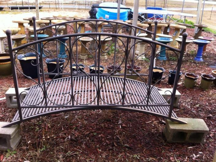 [Image: This iron bridge would be perfect over a small pond or as a display in your front yard. ]